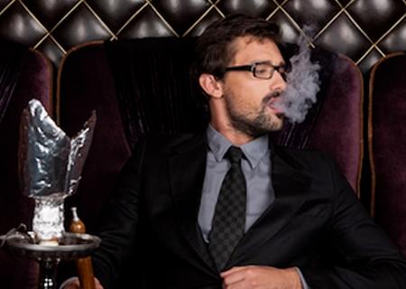 Young men smoking pipes